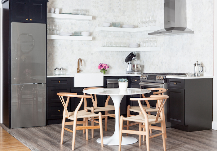 small black and white kitchen with marble saarinen dining
