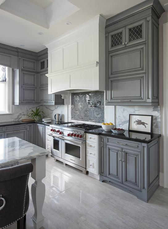 White kitchen hood with dark gray mosaic cooktop for Grey blue white kitchen