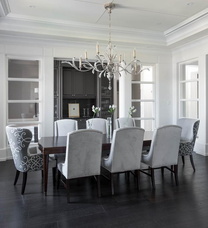 Chic Dining Room Features A Tray Ceiling Accented With Satin Nickel And Glass Chandelier Illuminating Dark Stained Curved Table Lined Dove