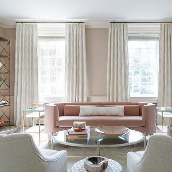Pink velvet curved sofa with brass tiered end tables - Pink and gold living room ...