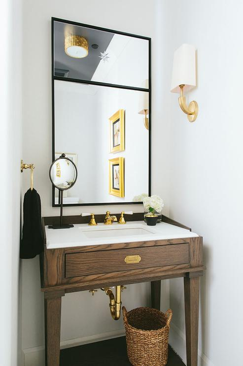 Black and gold powder room with gold oval sunburst mirror for Powder bathroom vanities