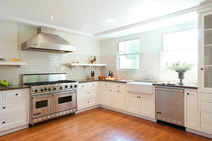 white kitchen with cream subway backsplash tiles - transitional