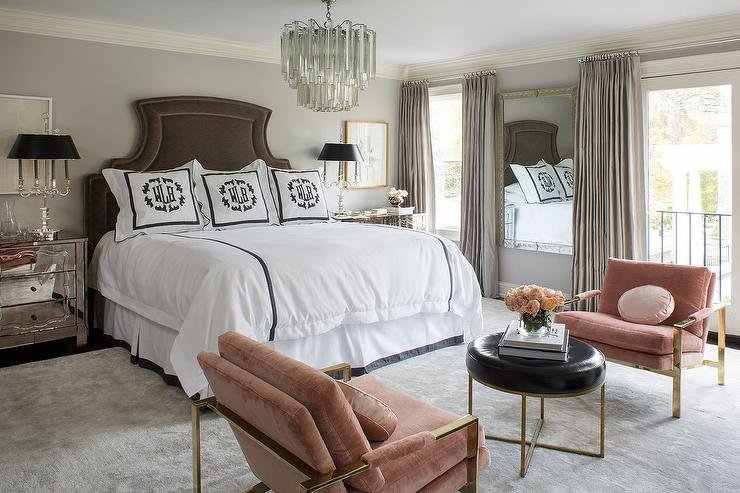 brown and pink bedroom with art deco chandelier