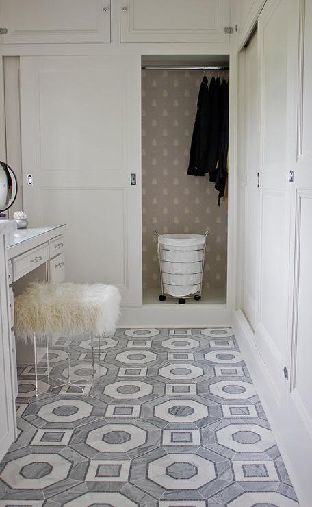 Master Bathroom Closet With Sliding Doors And Bumblebee Wallpaper