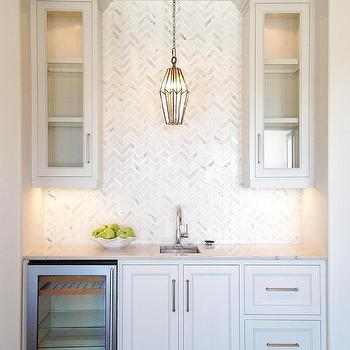 Wet Bar With Rift Sewn Oak Cabinets And White Glass