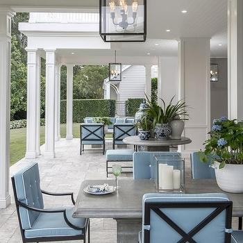 Superb Gray Outdoor Dining Table With Wrought Iron Dining Chairs And Blue Cushions Home Design Ideas