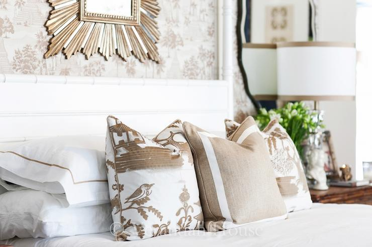 welcoming white and brown bedroom features a white bamboo 4 poster bed