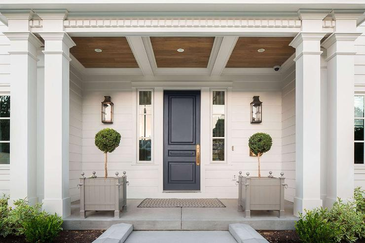 Portico With Dark Blue Front Door Transitional Home