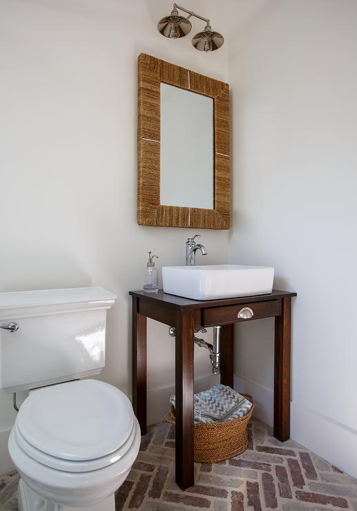 Powder room with seagrass mirror and table turned sink for Powder room vanity sink