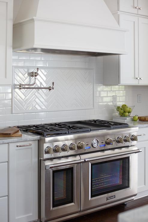 White Herringbone Stovetop Tiles With Swing Arm Pot Filler