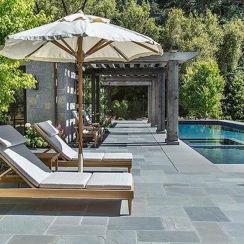 Gray Pool Loungers And Aqua Umbrellas Traditional Deck