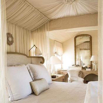 Gray French Wingback Bed with Sheer Curtains & Sunburst Mirror Over Bed Design Ideas