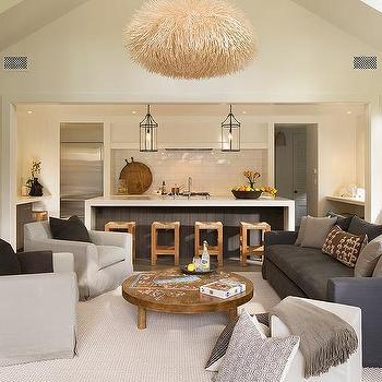 https://cdn.decorpad.com/photos/2016/05/20/m_vaulted-living-room-ceiling-dark-gray-slipcovered-sofa-low-cocktail-table.jpg
