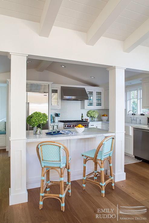 Small, cottage kitchen features an island lined with aqua French bistro bar  stools. - French Bistro Counter Stools Design Ideas