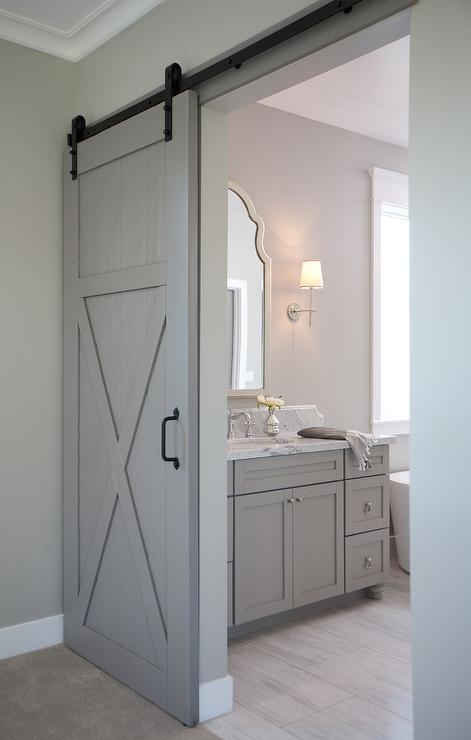 en suite bathroom with barn door on rails transitional bathroom. Black Bedroom Furniture Sets. Home Design Ideas