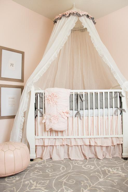 Pink Nursery Design With Caddy Corner Crib And Tulle