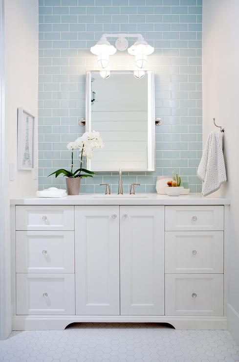 white bath vanity with blue subway tile backsplash
