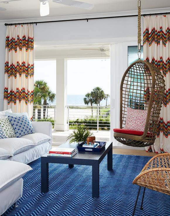 White And Blue Living Room With Rope Hanging Chair