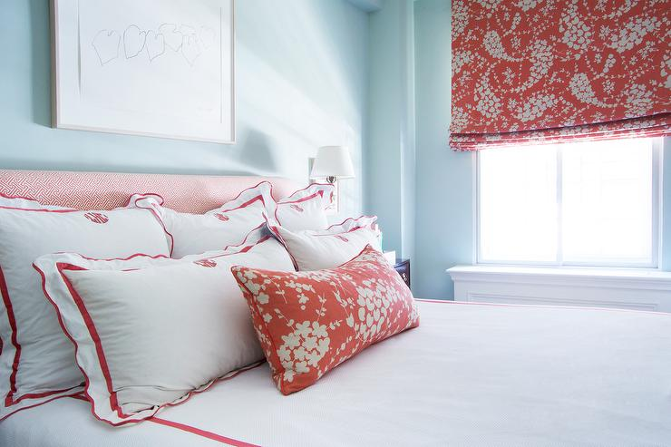 red and blue bedroom with red scalloped monogrammed bedding