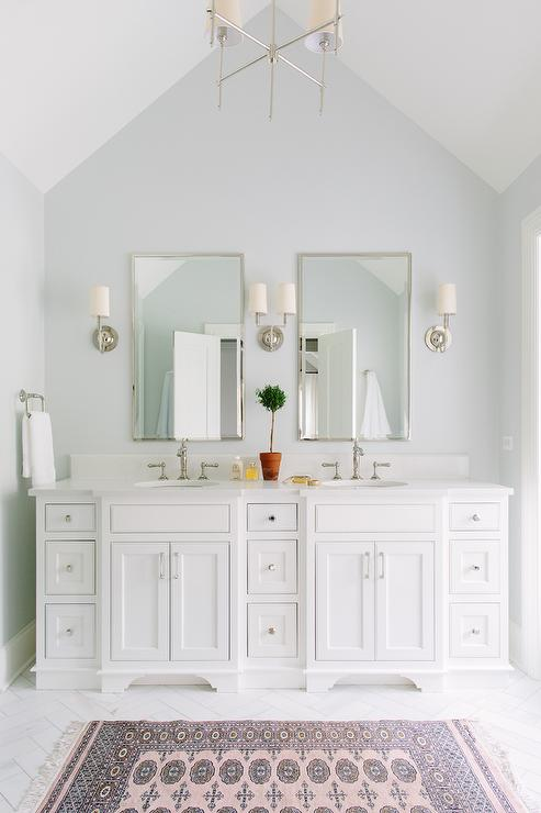Master Bathroom With Vaulted Ceiling And Pink Rug Transitional - Master bathroom sconces