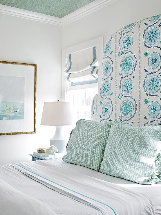 Blue and green cottage bedroom with green grasscloth on ceiling