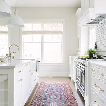 White Kitchen With Rustic Wood Ceiling Beams And Red Blue Kilim Rug