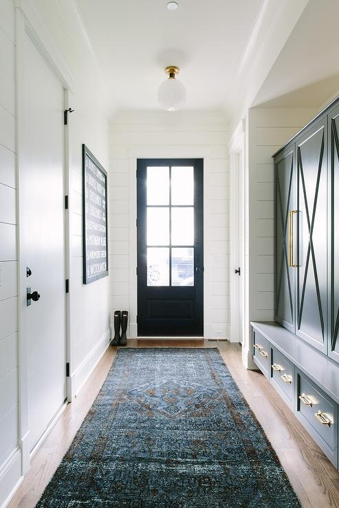 Navy Mudroom Cabinets And Bench With Brass Hardware