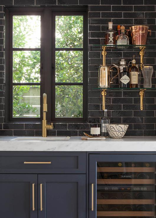 glossy black wet bar backsplash with glass and brass shelves