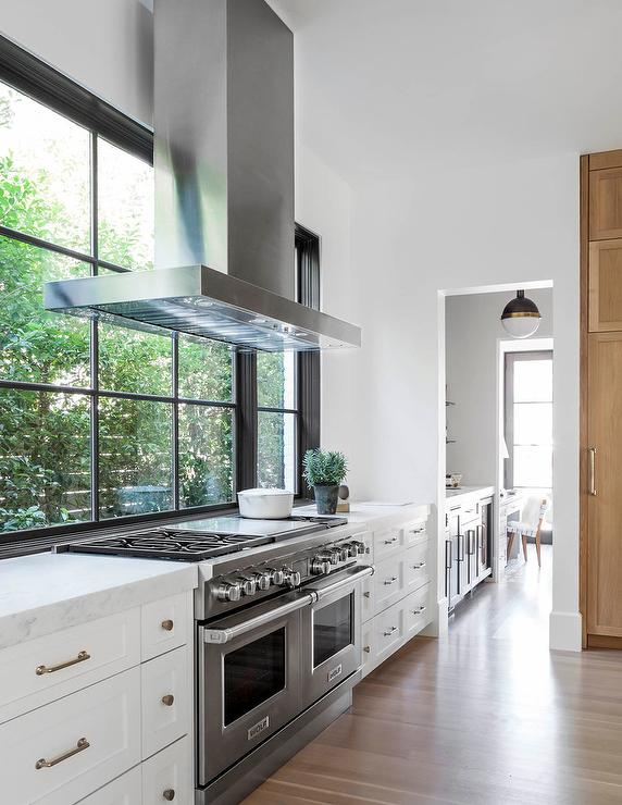 Kitchen Range Hood Placed In Front Of Windows Cottage