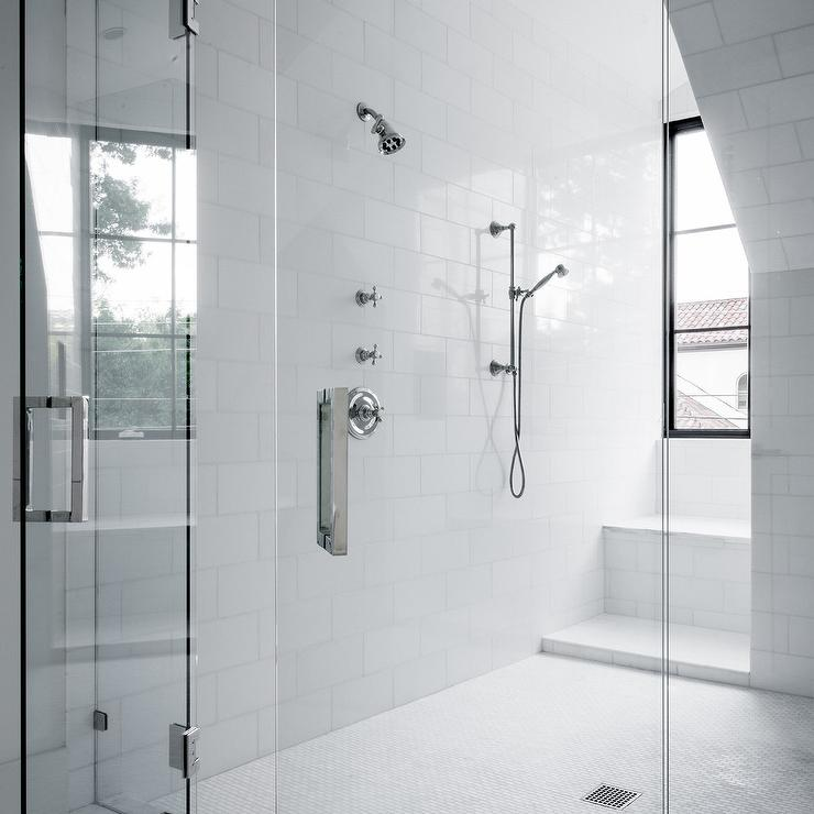 Spacious Walk In Shower Boasts Walls Clad In Large White Subway Tiles Lined  With A Polished Nickel Modern Shower Kits.