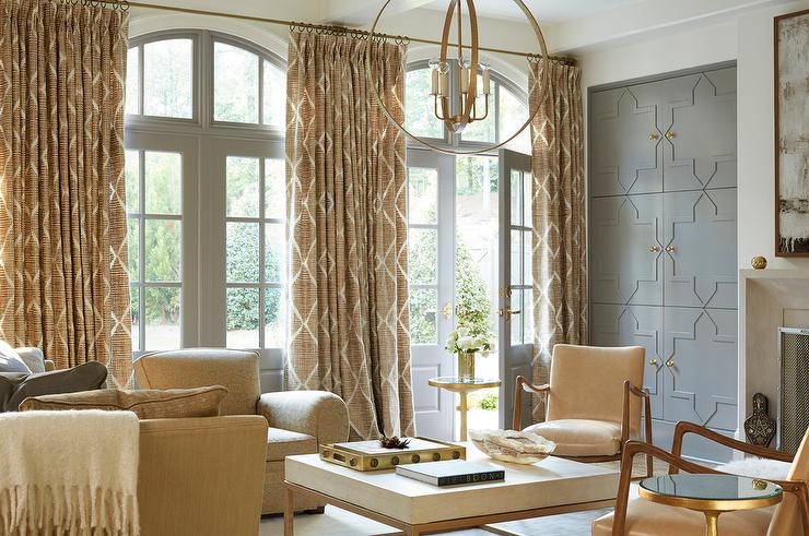 Wall Of Gray Living Room Doors Dressed In Gold Lattice Curtains