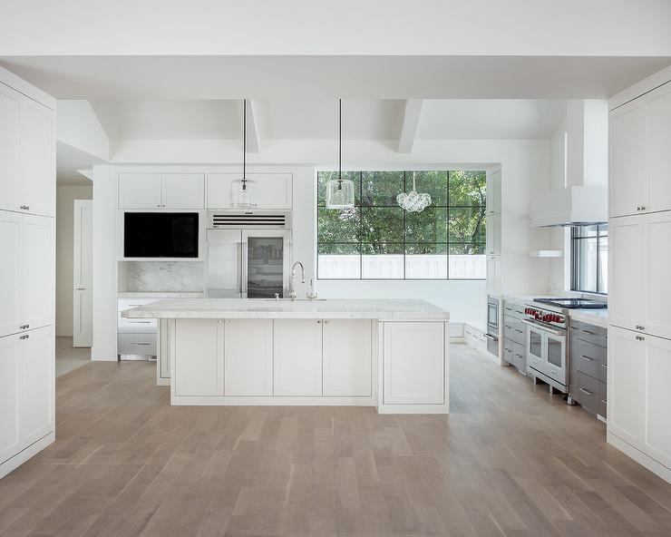 White modern kitchen with gray wash wood floors modern for White kitchen cabinets with hardwood floors
