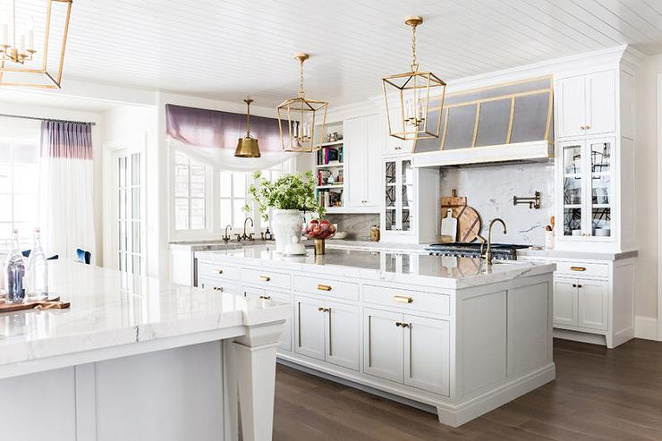 Two Kitchen Islands With Vintage Brass Pulls And Antique