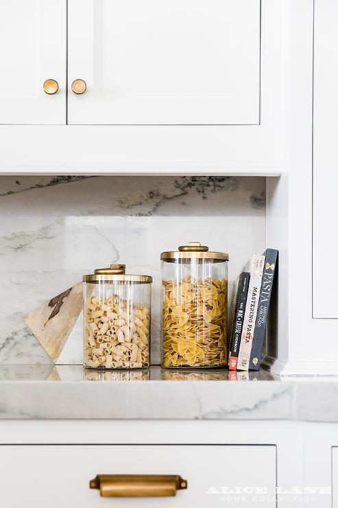 Chic Kitchen Features White Shaker Cabinets Adorned With Brushed Brass Knobs  And Vintage Brass Pulls, Pottery Barn Boulevard Knob U0026 Pull, Paired With  Gray ...