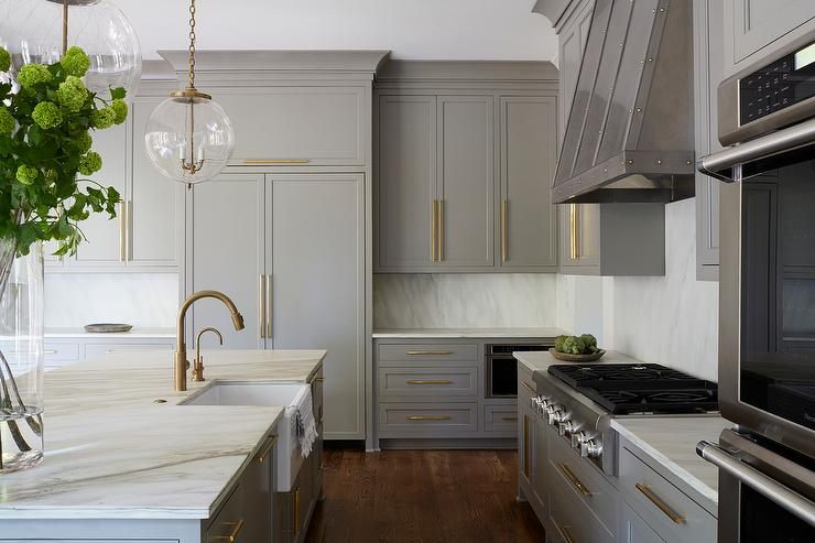 White Shaker Kitchen Cabinets With Brushed Brass Knobs And