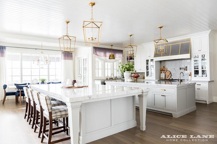 Two Kitchen Islands Unified With Brass Lanterns