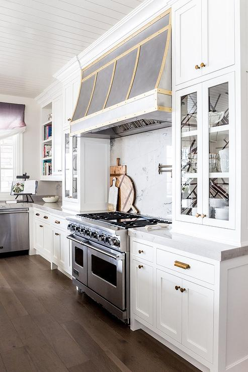 Glass Front Cabinets Flank Stovetop Transitional