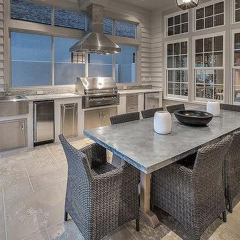 white brick outdoor kitchen with reclaimed wood vent hood