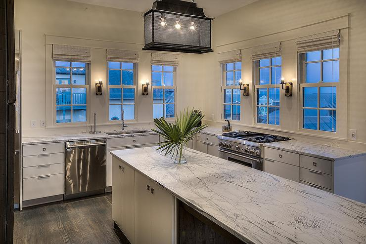 Beach Cottage Kitchen Features A Long Kitchen Island Fitted With Gray And  White Marble Countertops Lit By A Black Carriage Lantern While L Shaped  Flat Front ...