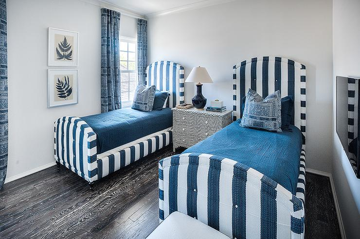 Blue boys  bedroom features navy blue table lamp sat atop a Bernhardt  Herringbone Drawer Cabinet flanked by upholstered blue striped twin beds  boasting a. Gray And Blue Boys Rooms Design Ideas