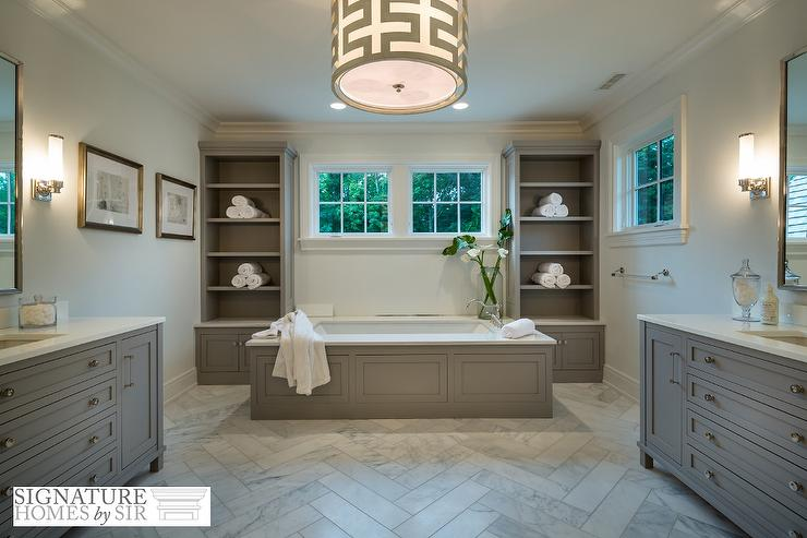 Gray Wainscoted Bathtub Flanked By Tall Gray Built In