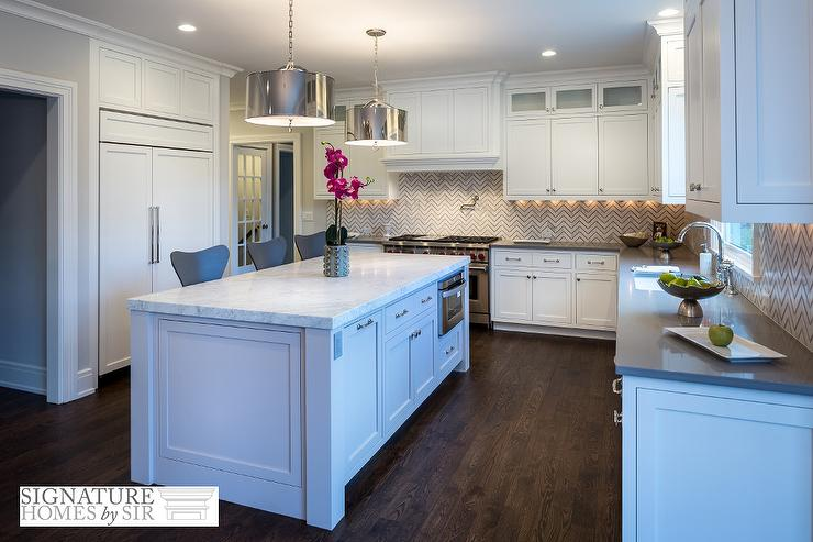 White And Gray Kitchen With Marble Chevron Tile Backsplash