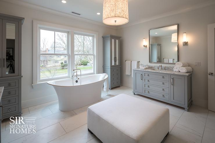 Bathtub Between Tall Freestanding Gray Mirrored Linen