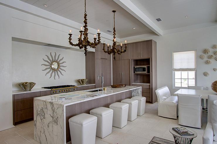 Long Kitchen Island With White And Gray Marble Waterfall