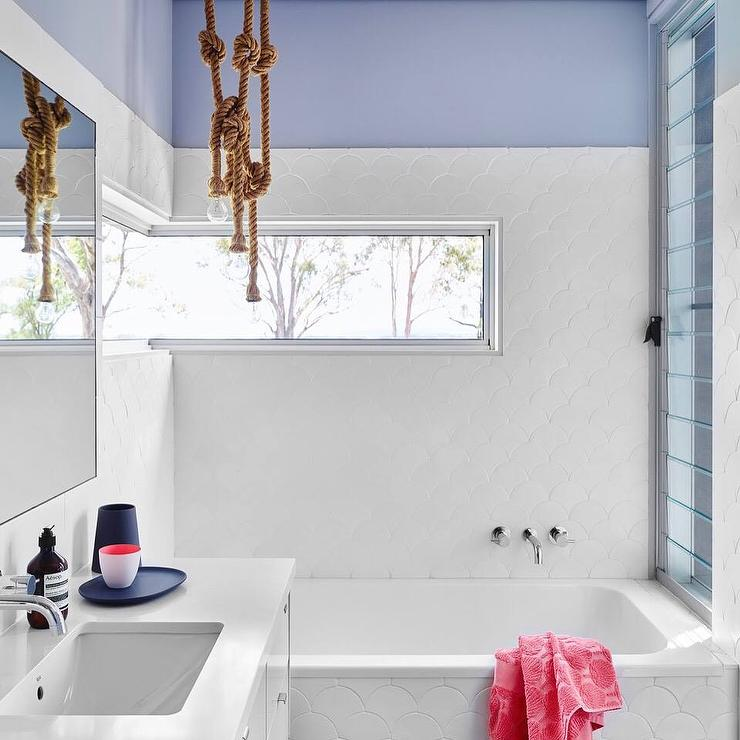 Bathroom With White Fish Scale Tiles And Rope Light Pendant