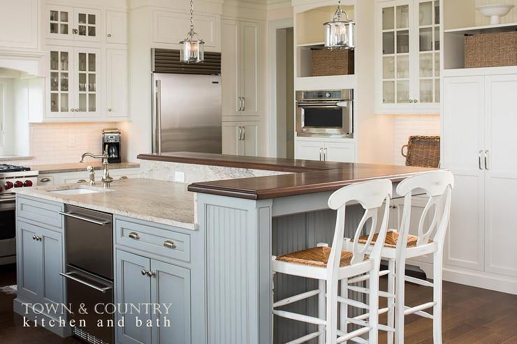 blue beadboard kitchen island with white rush seat bar stools