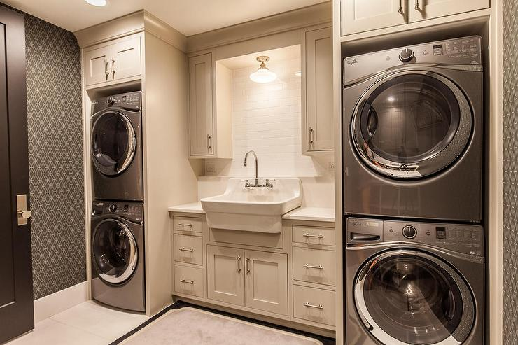 Contemporary Laundry Room with two Sets of Stacked Washers and ...