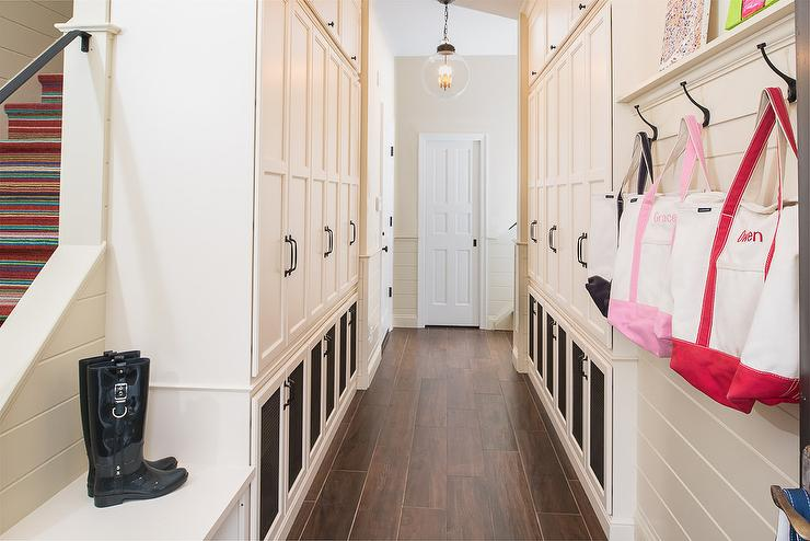 Long Mudroom Design With Face To Face Locker Cabinets