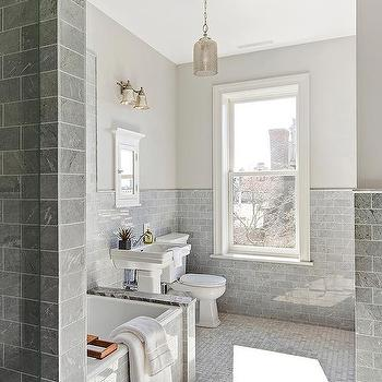 Gray Marble Subway Tiles On Bathtub With Mercury Glass Pendant