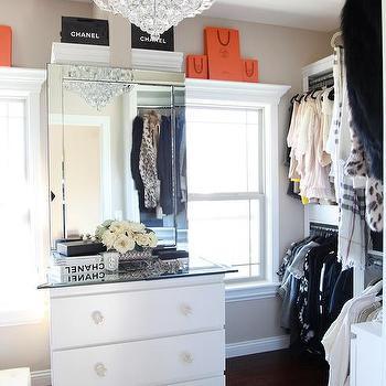 Walk In Closet With Mirror Above Dresser